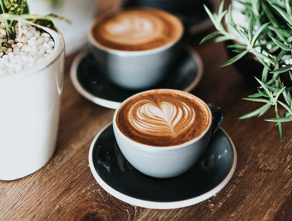 Milky coffees on a nice table